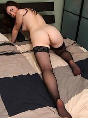 Leggy kitty wearing nothing but black stockings