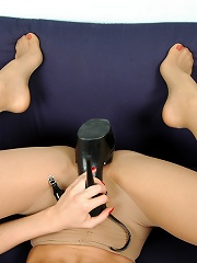 Hottie in spike heel sandals dusting her well-maintained feet clad in nylon