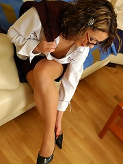 Sultry business-lady massaging every toe of her yummy feet clad in nylon