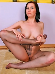 Luscious brunette demonstrating her extremely seductive feet clad in tights