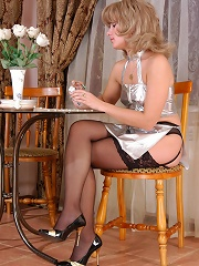 Provokingly dressed chick in lace top stockings tasting pussy of a waitress