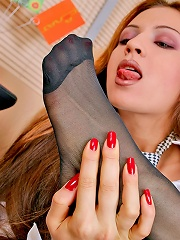 Hot secretary teasing with her black reinforced toe pantyhose in her office