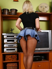 Gorgeous round ass in black see-through pantyhose