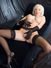 Stockinged slut playing with two dildos at a time