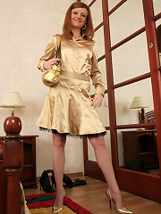 Nylon-loving redhead gets horny changing clothes