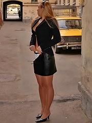 Shameless pantyhosed model posing in public place
