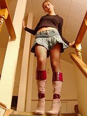 Upskirt shoots of fingering beauty in stockings
