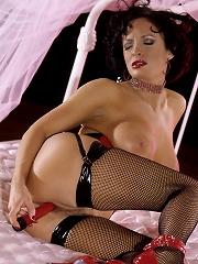 Slut With Black Fish Net Stockings Uses Dildo