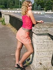 Blonde pantyhose model poses naked near highway