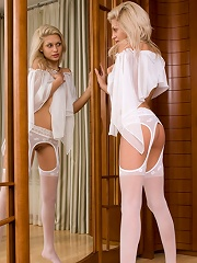 Stunning nylon-loving temptress in front of mirror