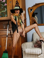 Raunchy witch in fishnet hose dildoes her smoothie