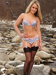 Irresistable babe Candice frecking hot teasing in the rocks wearing her black stockings
