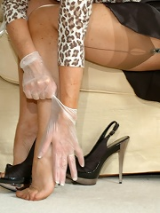 Seamed blonde plays with latex gloves
