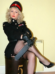 Strict officer poses and flashes