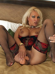 Leggy Lana wearing red and black lingerie and playing with dildo