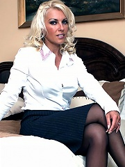 Sexy blonde bombshell Lana takes off her work suit nice and slow