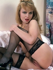 Naughty blonde posing naked wearing only stockings flaunting her ass
