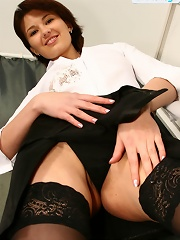 Skinny beauty shows long legs in hot black tights