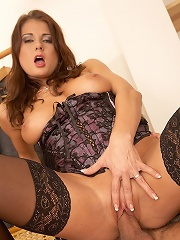 Melanie in black lace stockings gets drilled from behind