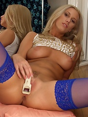 Nasty blonde slut pinching clit with an eyelash curler