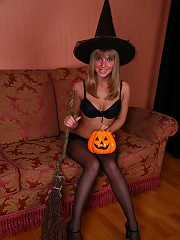 Uber-sexy Halloween witch in sheer black tights