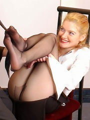 Lusty babe in black tights giving footjob longing to get her snatch licked